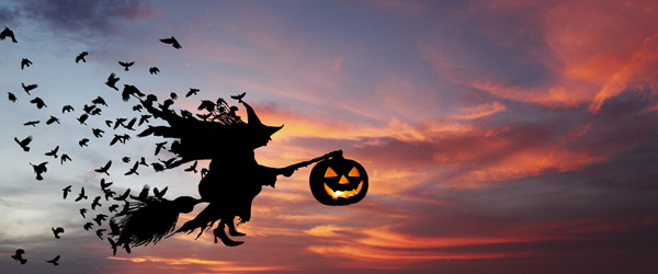 Flying-Witch-on-a-Broomstick-with-a-Pumpkin-Lantern-Featured