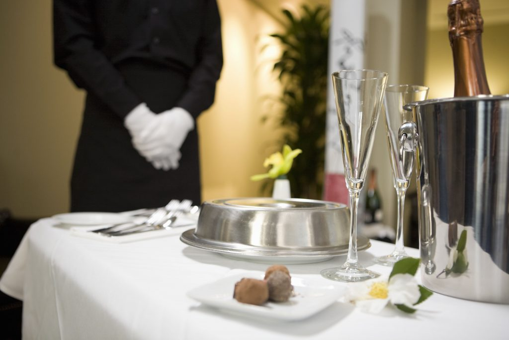 room-service-tray-with-food-and-champagne-80648485-59306bb55f9b589eb46068ba